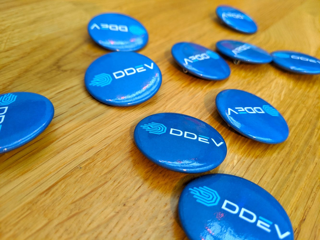 DDEV swag logo buttons