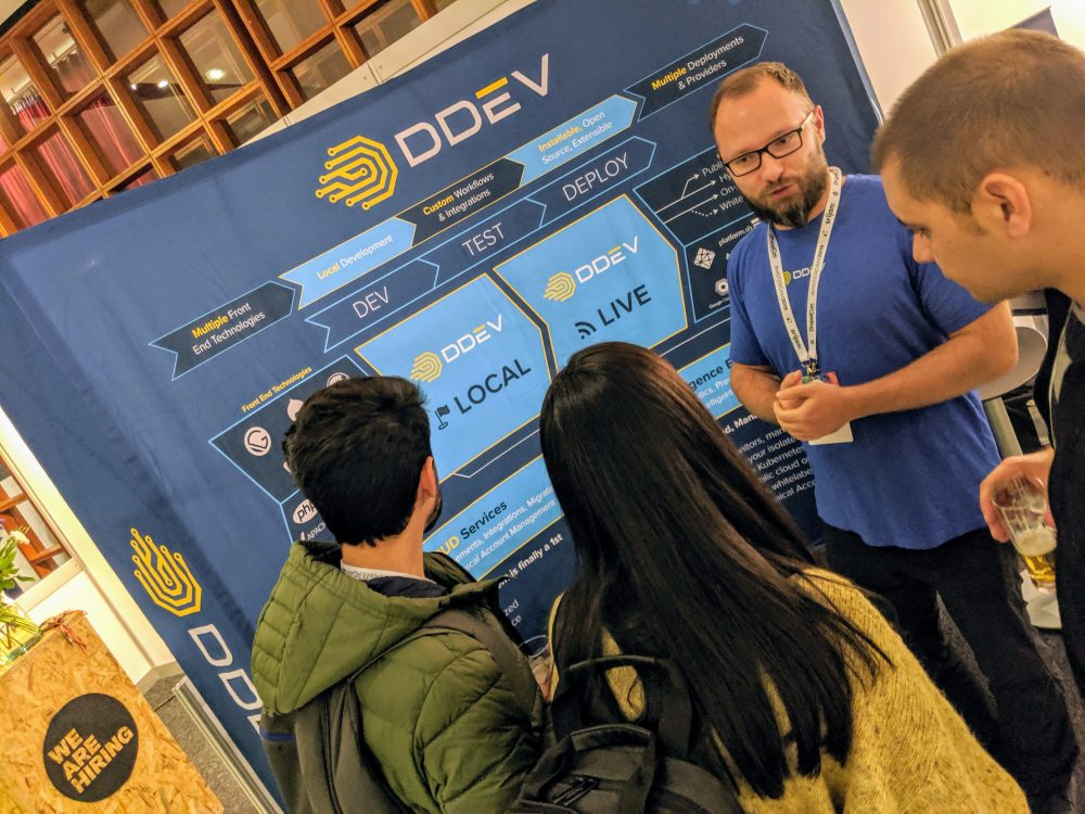 DDEV team member Jan talking to visitors at the booth